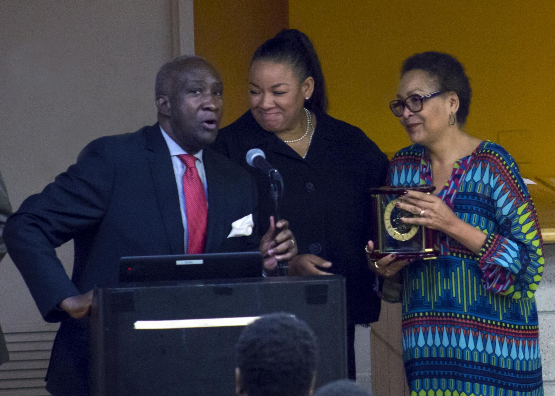 Lloyd Williams, president and CEO of the Greater Harlem Chamber of Commerce, presenting the Outstanding Professional Achievement Award to La-Verna Fountain (right).